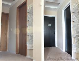 interior trim painting ideas with white and black contrast for a modern decor this hallway