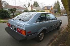 OLD PARKED CARS.: 1982 Toyota Corolla Liftback.