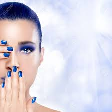 beautiful young woman with hands on her face covering one eye and mouth perfect skin nail art and makeup concept high fashion portrait