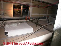air conditioning damper. fire damper between sections of a commercial building ceiling used for return air (c) conditioning