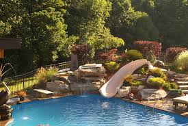 Exciting Slidebuiltinwaterfall With Slides Diving Boards Chaffees Swimming  S in Swimming Pool Slides