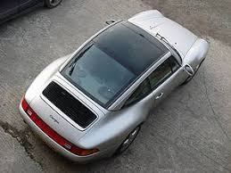 993targa jpg the roof of the car is composed of 3 glass panels a wind deflector the sunroof and the rear screen