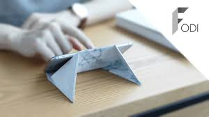 FODI is an Origami stand that folds to different sizes to fit your mobile  devices,