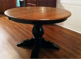 a round albany single pedestal dining table in oak with an acorn stained top and