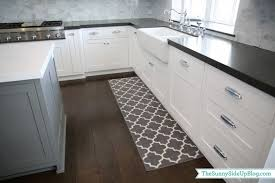 modern rectangle shaped long kitchen rugs in gray tone next to kitchen sink over window