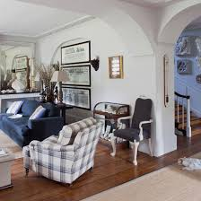 Open Plan Living Room With White Walls, Wood Flooring, Neutral Rug, Blue