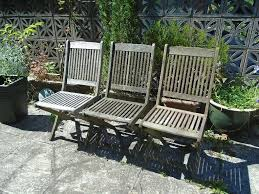 3 used wooden garden chairs