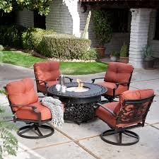 black wrought iron patio furniture with cushions and