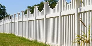 white vinyl fence with contemporary look surrounding a homes back yard