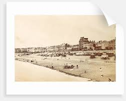 buildings bathers and bathing carriages on brighton beach uk by anonymous