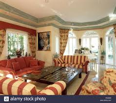 striped sofas living room furniture. Red Striped Sofas Set Around Carved Wood Coffee Table In Living Room Large Spanish Villa Furniture D