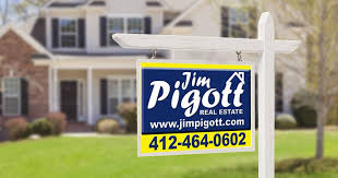 Jim Pigott Real Estate sign in front of house for sale