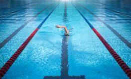 one man swimming on swimming pool lane one man swimming on swimming pool line in