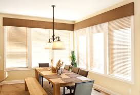 cozy dining room design with wooden dining table and leather dining chairs also pendant lighting plus decorating windows with cornice boards ideas