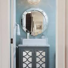 blue and gray powder room with capiz flower pendant