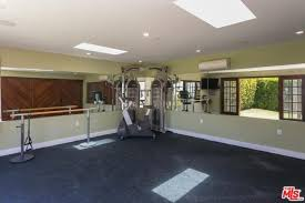 home gym lighting. Large Home Gym With Carpet Flooring And Regular Ceiling Recessed Lights.Zillow Digs Lighting O