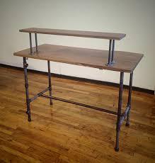 diy pipe sit stand desk two tiers design on wood floor