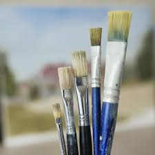paintbrushes in increasing height order close up