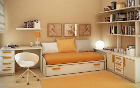 Furniture. white wooden desk with drawers connected by orange bed sheet on  white wooden bed