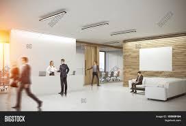 office corridor door glass. People In Corridor Of Office With Reception Counter And Meeting Room Glass Doors. Concept Door