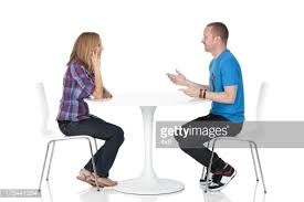 people sitting at table white background. couple sitting across from one another at a table stock photo | getty images people white background