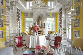 white and soft grey set the stage but the bright yellow walls pink flowers and chairs bordering on red are the stars of this room