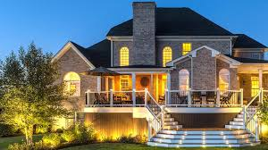 deck lighting. The Deck On Large Brick House Is Shown At Dusk With Trex Landcape Lighting  And LED