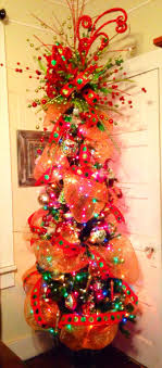 Whimsical Christmas Tree with outrageous topper!