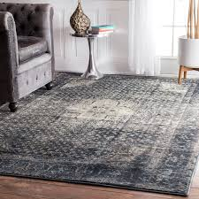 gray overdyed rugs with black leather armchair and round table plus brown curtains for interior design ideas