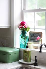 window sill ideas.  Ideas Back Splash Over Kitchen Sink With Wood Trimmed Window With Window Sill Ideas