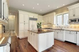 white cabinet kitchen with tile backsplash
