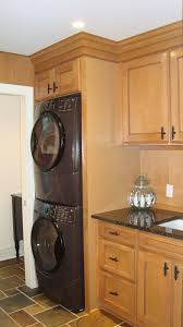 stacked washer dryer Laundry Room Traditional with built in ...