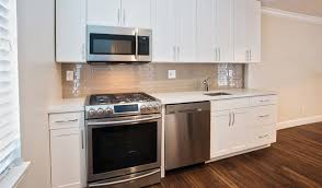 premier townhomes have modern kitchens featuring quartz countertops ge caf stainless steel appliances