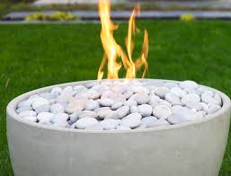 fireproof river rocks top this clean firebowl