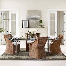 an airy rattan weave gives this chair a cal elegance that suits relaxed entertaining handcrafted with naturally strong resilient materials