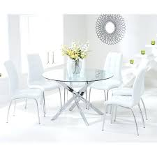 modern round glass dining table with 4 white chairs inside and decorations 3 set a