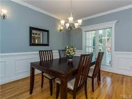 traditional dining room with crown molding chair rail in wallpaper dining room chair rail