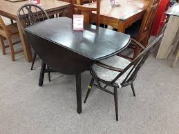 ercol dining table 2 chairs dark wood