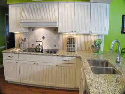 white beadboard cabinet doors. Kitchen Designed WIth Granite Countertops And Beadboard Cabinet Doors In White Colors T