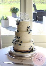 Buttercream Wedding Cake With Navy Butterflies And Sugar Flowers