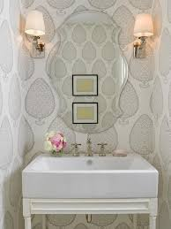 High Quality Pretty Powder Room Features Katie Ridder Leaf Wallpaper On Walls Framing A  Scalloped Beveled Mirror Flanked By A Pair Of Polished Nickel Sconces With  Ivory ...