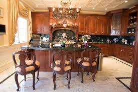 kitchen island granite top sun: this dark wood kitchen features matching large island with black marble countertop complete with second