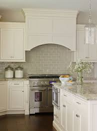 wide plank floors glazed subway backsplash simple cabinets and handles kitchen tile designs
