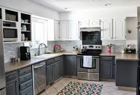 grey kitchen cabinets with black countertops grey metal chrome single bowl sink dark brown varnish wood flooring black marble counter top stained aluminium