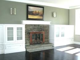 built ins around fireplace ideas with doors stone in cabinets white and book cabinets next to fireplace bookcases built in around shelves white each