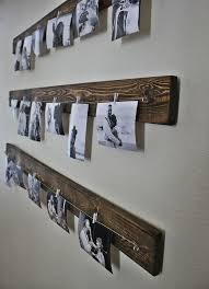 hipster way of displaying your family photo is done easily with wooden  planks, clips and