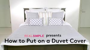 how to put a comforter in a duvet thumb how to put on duvet cover bath how to put a comforter in a duvet