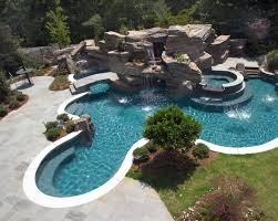 Elaborate Swimming Pool Featuring Large Grotto Waterfall And Tube .