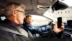 couple driving using cell phone to navigate