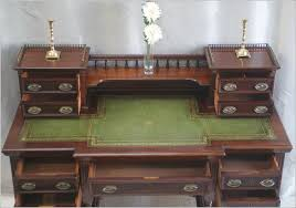 many features typical of the more elaborate writing desks of this period including the raised structure with miniature pedestals with drawers a raised rear